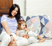 Portrait of mother and daughter lat home, happy family smiling, lifestyle people concept Stock Photo