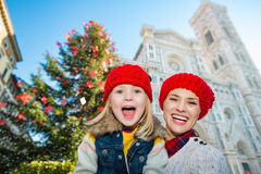 Portrait of mother and daughter near Christmas tree in Florence Royalty Free Stock Photo