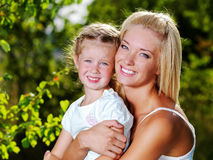Portrait of  mother and daughter outdoors Stock Photos