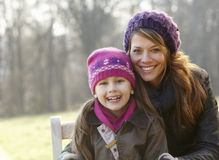 Portrait mother and daughter outdoors in winter Stock Images