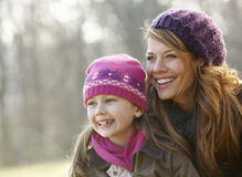 Portrait mother and daughter outdoors in winter Stock Photo