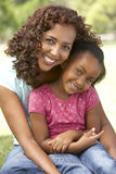 Portrait Of Mother And Daughter In Park Royalty Free Stock Images