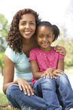 Portrait Of Mother And Daughter In Park Stock Photo