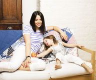 Portrait of mother and daughter playing in bed, lifestyle people concept Stock Photo