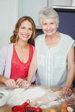 Portrait of mother and daughter preparing food Royalty Free Stock Image