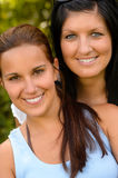 Portrait of mother and daughter smiling outdoors Royalty Free Stock Images