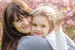 Portrait of mother and daughter on spring background Stock Photography