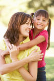 Portrait Of Mother And Daughter Together In Park Stock Photo