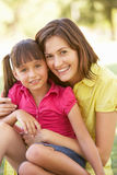 Portrait Of Mother And Daughter Together In Park Stock Photography