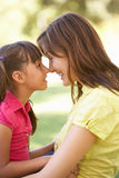 Portrait Of Mother And Daughter Together In Park Royalty Free Stock Photos