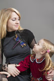 Portrait of Mother and Daughter Together in Studio Envirinment. Royalty Free Stock Image