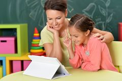 Portrait of mother and daughter using tablet together royalty free stock photos