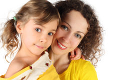 Portrait of mother and daughter in yellow dress Royalty Free Stock Photo