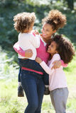 Portrait Of Mother With Daughters In Countryside Stock Photography