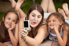 Portrait of mother and daughters making faces on self shot Royalty Free Stock Photo