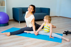 Mother doing yoga with daughter Stock Image