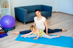Mother doing yoga with daughter Royalty Free Stock Images