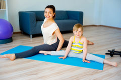 Mother doing yoga with daughter Royalty Free Stock Photography