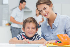 Portrait of a mother drawing with her son Stock Photography