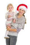 Portrait of mother and eating cookie baby girl. Christmas portrait of happy mother and eating cookie baby girl Royalty Free Stock Photography