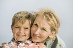Portrait of mother embracing son outdoors Royalty Free Stock Photos