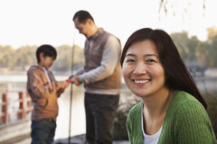 Portrait of mother with family fishing at a lake Stock Photography