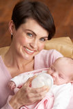 Portrait Of Mother Feeding Newborn Baby Stock Photo