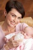 Portrait Of Mother Feeding Newborn Baby Stock Photo