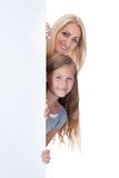 Portrait Of Mother and Girl Behind Blank Board Royalty Free Stock Photos