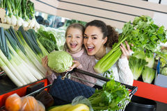 Portrait of mother and girl choosing celery Stock Photography