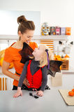 Portrait of mother with girl in halloween bat costume Royalty Free Stock Photos