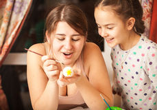 Portrait of mother and girl painting easter eggs Royalty Free Stock Image