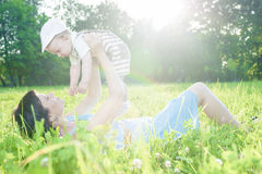 Portrait of Mother with Her Adorable Cute Son Against Nature Baclground Royalty Free Stock Photos