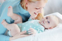 Portrait of a mother with her baby Stock Photos