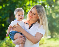 Portrait of a mother and her baby Royalty Free Stock Photos