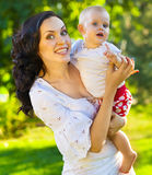Portrait of a mother and her baby outdoors Royalty Free Stock Image