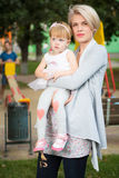 Portrait of a mother with her child. Portrait of a mother with her 2 years old child Royalty Free Stock Photos