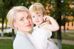 Portrait of a mother with her child. Portrait of a mother with her 2 years old child Stock Photography