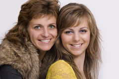 A portrait of a mother and her daughter. A studio portrait of a mother and her daughter stock photography