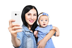 Portrait of a mother and her daughter, making selfie on phone Stock Photos