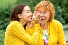 Portrait of mother with her daughter in the park stock image
