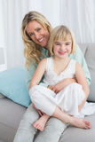 Portrait of a mother and her daughter posing on the couch Stock Images