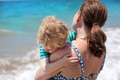 Portrait of mother and her little son on the beach Stock Images