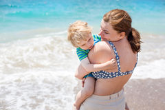 Portrait of mother and her little son on the beach Royalty Free Stock Image