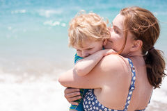 Portrait of mother and her little son on the beach Stock Photo