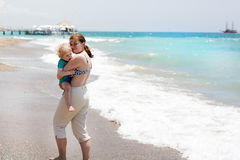 Portrait of mother and her little son on the beach Stock Photos