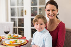 Portrait of mother with her son sitting on lap Stock Photos