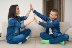 Portrait of mother and her son on sofa at home Stock Images