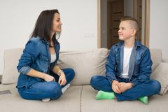 Portrait of mother and her son on sofa at home Royalty Free Stock Photography