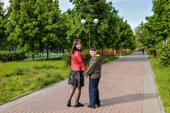 Mother and son walking in a park. spring sunny day royalty free stock photo
